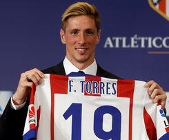 Atletico Madrid have announced that Fernando Torres has rejoined the club in a loan deal from AC Milan until the end of next season.