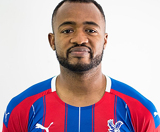 Crystal Palace have signed Swansea City forward Jordan Ayew on a three-year deal.