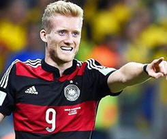 Andre Schurrle has completed a £22m move from Chelsea to Bundesliga side Wolfsburg.